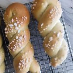 Two twists of sweet yeast dough after being rolled in pearl sugar and baked to a golden brown