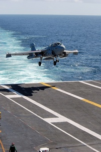 Stock Photography Image: A Jet Landing on an Aircraft Carrier's Flight Deck