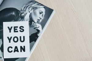 Woman on a magazine with caption: Yes You Can.