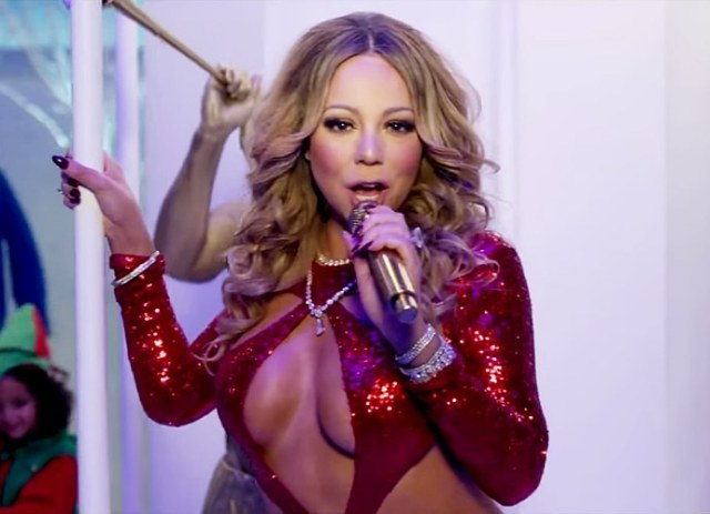 Mariah Carey Bares Ample Cleavage in 'Here Comes Santa Claus' Music Video