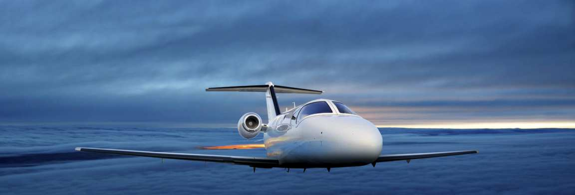 Executive plane flying at sunset
