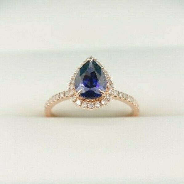 14k Rose Gold Pear Shape Tanzanite Halo Ring with Accent Diamonds