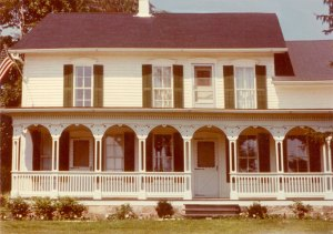 photo of front of Acheson family home showing full-width fancy porch