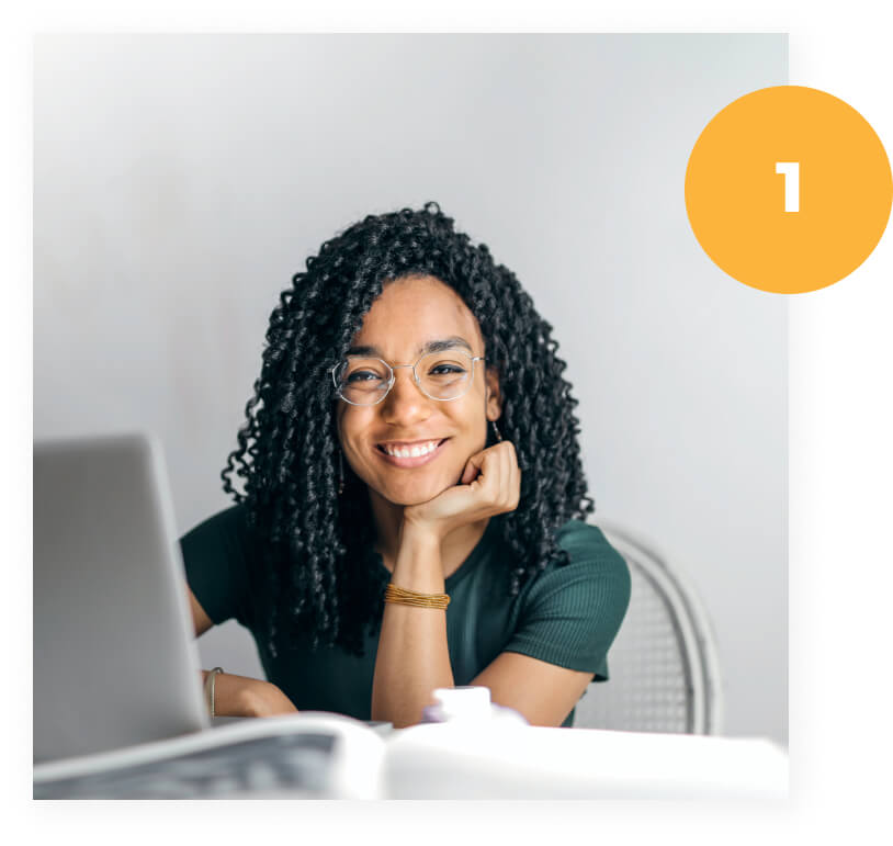 Afro-american woman sitting in the desk