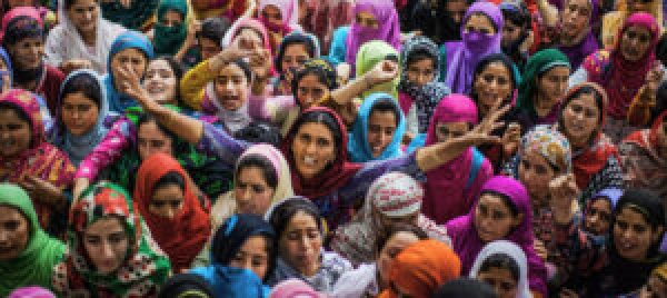 LARKIPUR , KASHMIR, INDIA - AUGUST 12: Kashmiri Muslim women shout anti Indian and pro Kashmir freedom slogans as they mourn during the funeral of Bilal Ahmad Bhat, 23, a civilian who was allegedly shot dead by Indian paramilitary Border Security Force (BSF) on August 12, 2015 in Larkipur, 35 km (21 miles) south of Srinagar, the summer capital of Indian administered Kashmir, India. Hundreds of Kashmiris participated in the funeral of Bhat who was killed by the Indian paramilitary BSF after they allegedly opened fire on the protestors who were protesting against the killing of two Lashkar-e-Taiba (Army of the Righteous), one of the largest and most active militant organization operating in Indian administered Kashmir, militants in an gun battle in Rakh-e-Lajura village of south Kashmir district on 11 August 2015. (Photo by Yawar Nazir/ Getty Images)