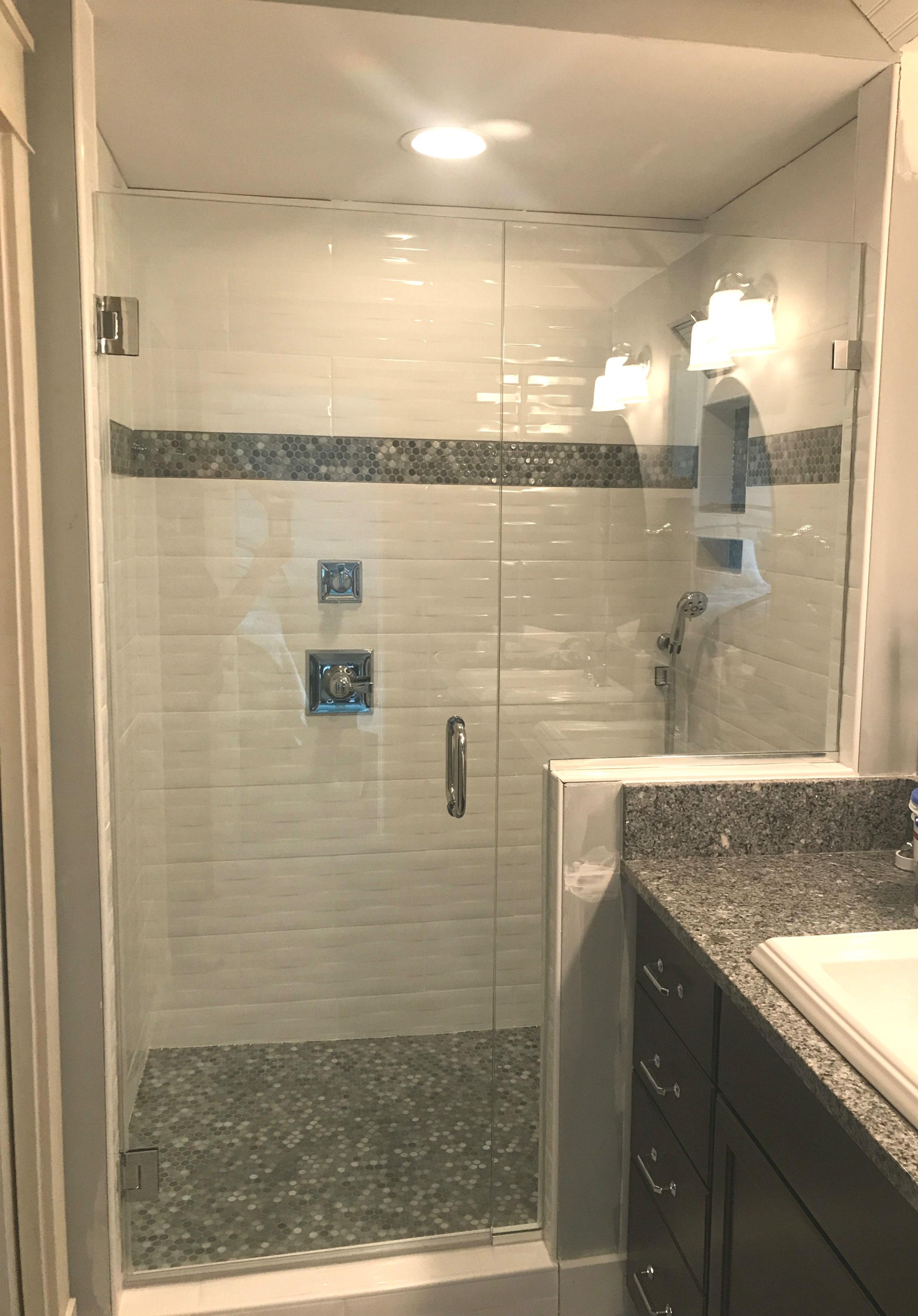 white tile shower with gray tiles