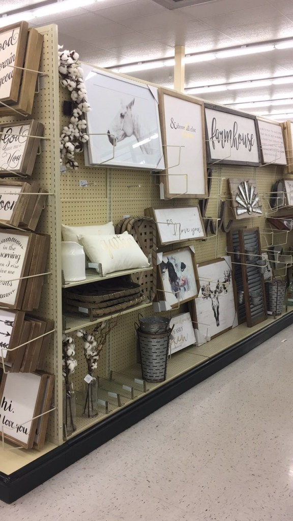 New farmhouse decor at hobby lobby a coastal cottage you can see a cotton wreath and the ironstone pitcher on the very left i am in love with that cow print but know it would be too much for my house gumiabroncs Images