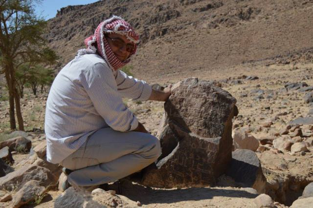Firas Bqa'in observes Nabataean inscriptions