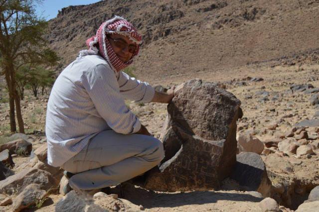 Firas Bqa'in observes Nabataean inscriptions