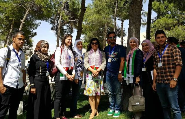 A group of SCHEP Scholars with H.R.H Princess Sumaya Bint Hassan (center) at ICHAJ 13. Photo by Dr. Barbara A. Porter.