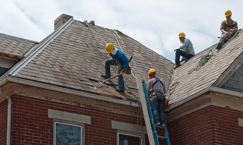 Roofers-Repairing-Roof-Blog-Post-Acord-Roofing-3-8-16-500x300