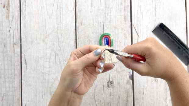 A step by step crochet tutorial showing how to crochet a funky pair of rainbow earrings that are perfect for gifting or selling at craft fairs!