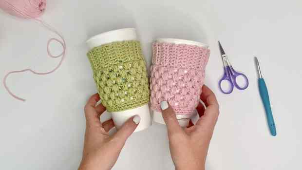Learn how to make an easy crochet coffee cup cozy with 100% cotton yarn and replace one-time use coffee sleeves. Includes a full video tutorial.