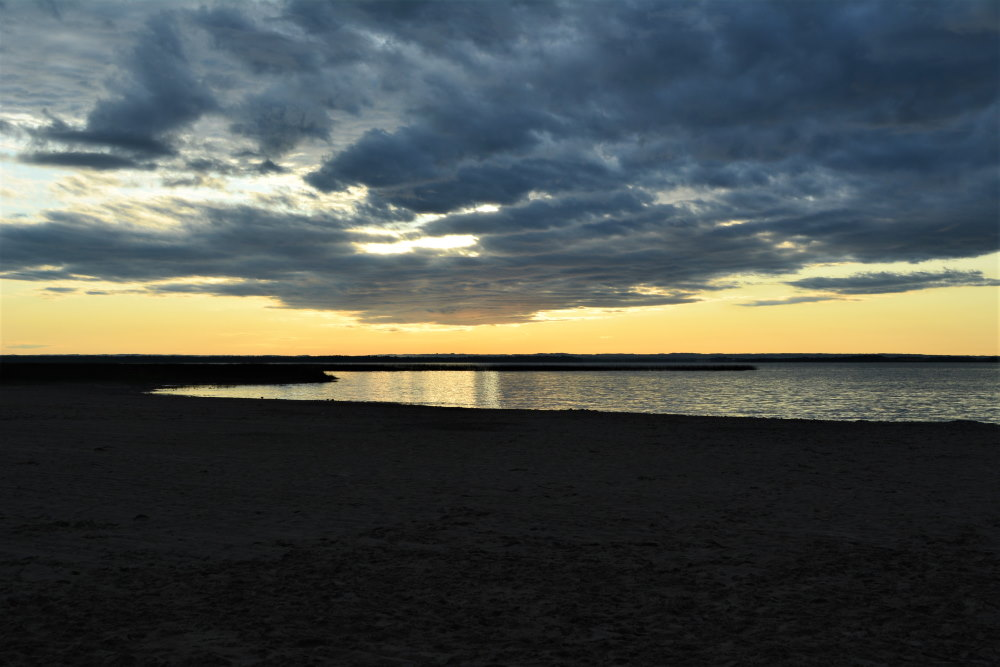 dusk starting looking over beach and lake in alberta canada