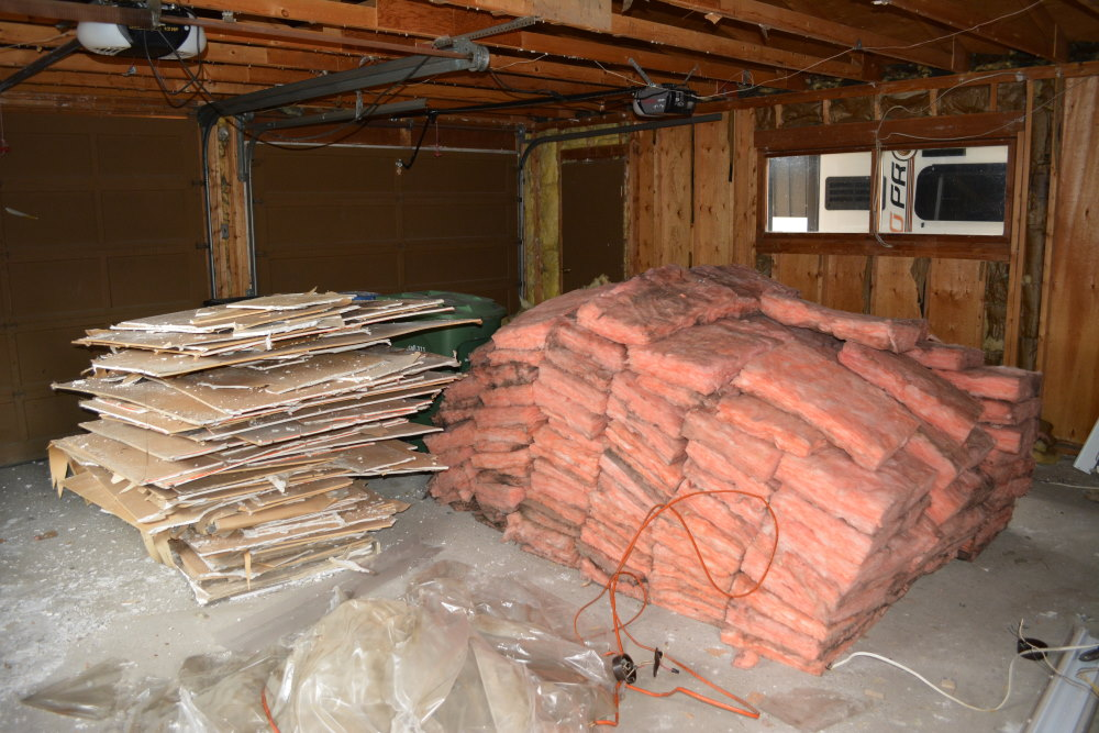 Piles of scrap drywall and insulation