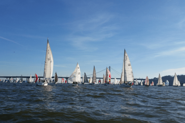 Sailboats competing in the Three Bridge Fiasco