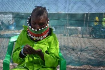 AAH Kenya Woman doing beadwork at Kalobeyei