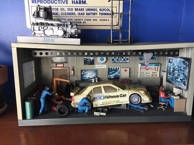 I had to have my car repaired the other day and at the shop there was this surprisingly detailed scale model of an auto shop... but look closer... all is not as it seems...