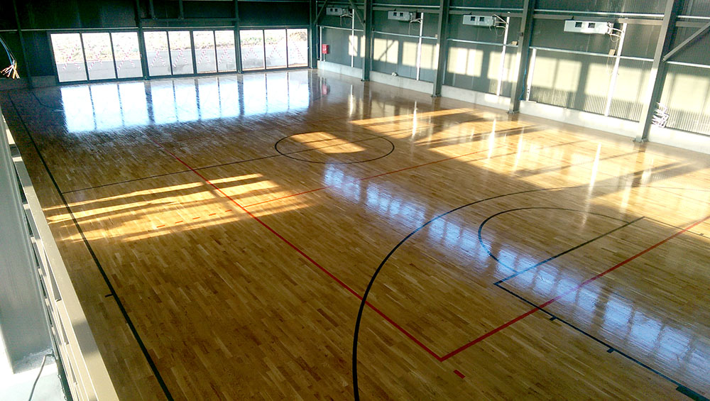 Supply and installation of parquet and sports equipment at the new facilities of the Academy DEKA.