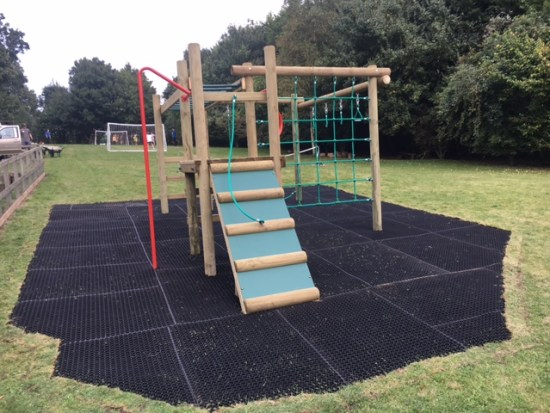 The Carleton 3 Climbing Frame with a scramble board, climbing net, fireman's pole, monkey bars - a horizontal latter travers & more