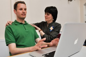 Jennifer working with student on easy computer use