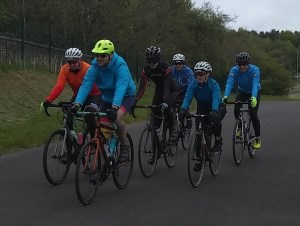 Riders in a close group during a group riding skills coached session