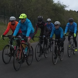 Cycling in a close group at the Fife Cycle Park