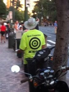 Man on a Honolulu street handing out gun range flyers