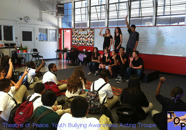 Image of Theatre of Peace Youth Bullying Awareness Acting Troupe having post-performance Q&A with student audience at a middle school. Kids helping kids.