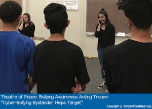 "Photo of Theatre of Peace Bullying Awareness Acting Troupe, a division of CA non-profit Act Like You Matter, performing Cyber-Bullying Bystander Helps Target Vignette. Each vignette we perform is from the script ""What If It Was You?"" by Amy Jones Anichini."