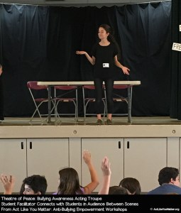Photo of Theatre of Peace Student Facilitator connecting with students in the audience between scenes. From Act Like You Matter: Anti-Bullying Empowerment Workshops.