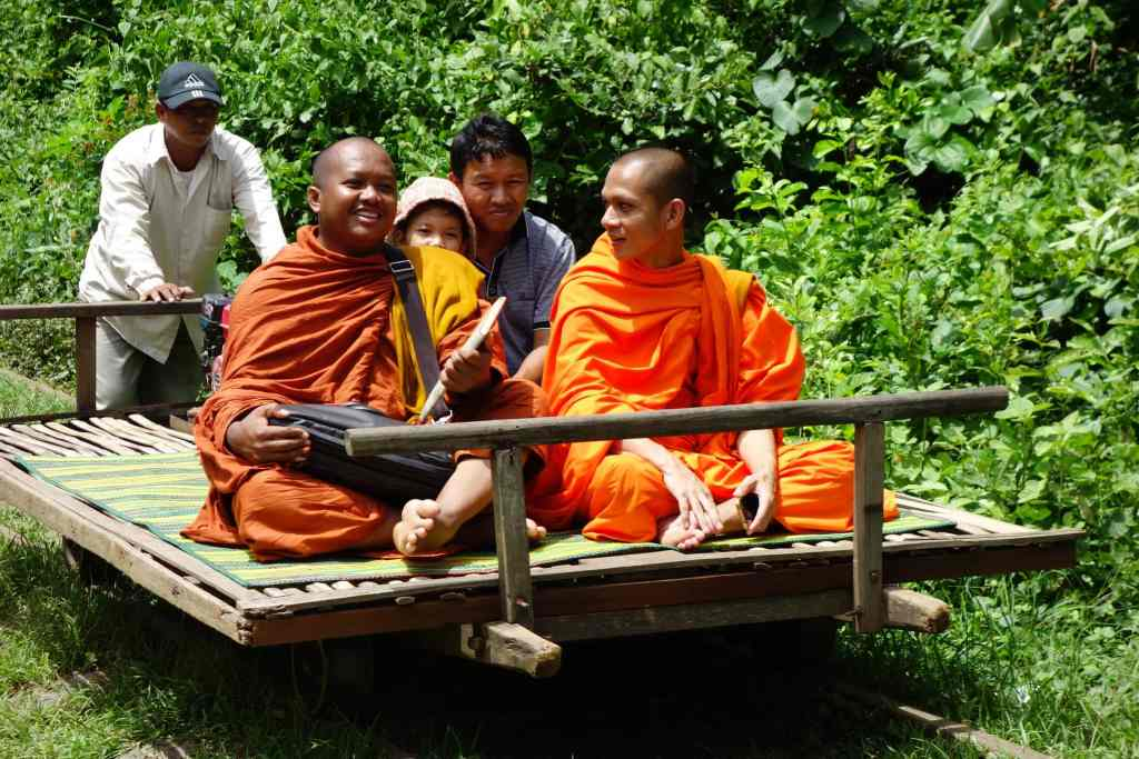 Monks on Bamboo train
