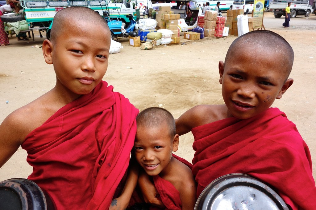 Three young monks in red clothes