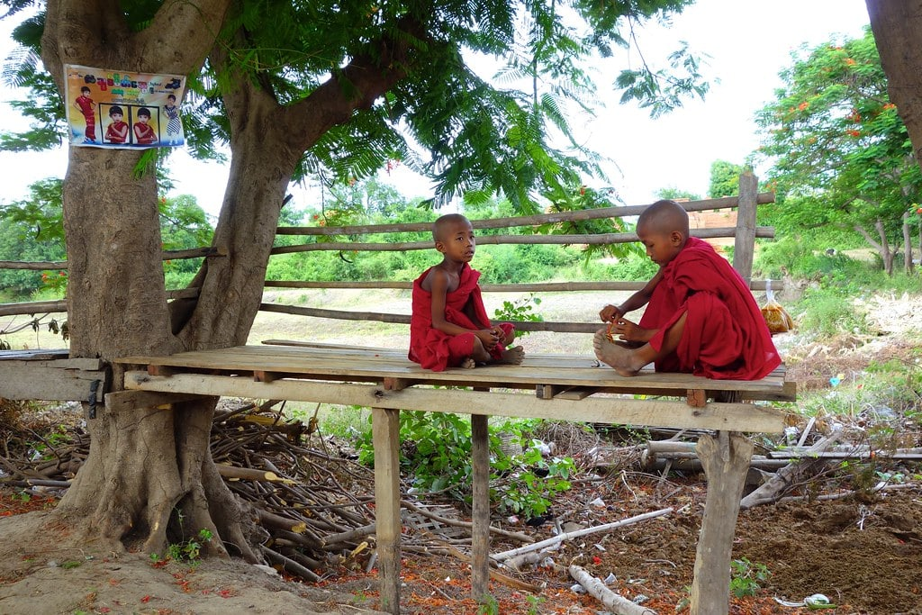 Two young monks playing a game