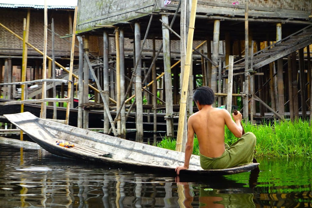 Man on boat near floating house