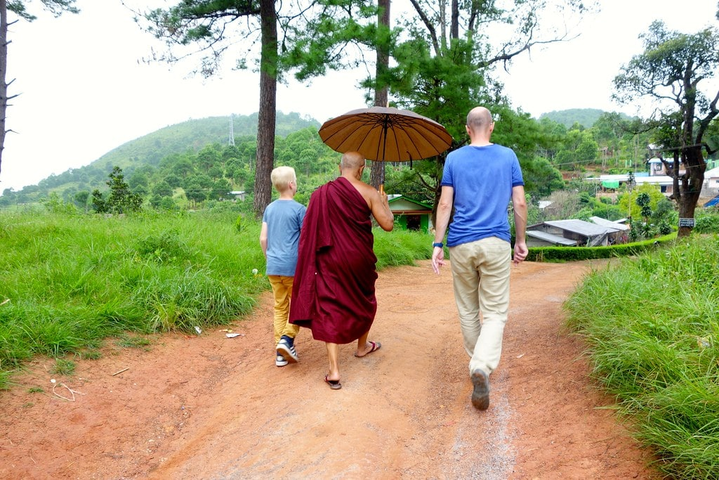 On our way up the hill with a local monk