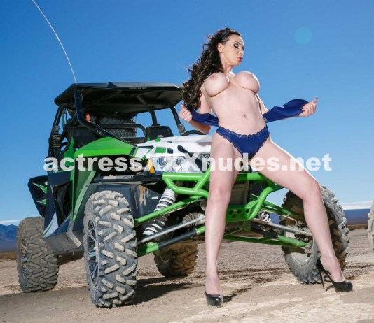 Sexy shots of porn star Nikki Benz driving a car in the desert