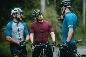cyclists with bikes speaking on road during break