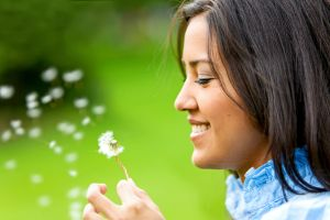 Woman enjoying nature, after acupuncture for allergies