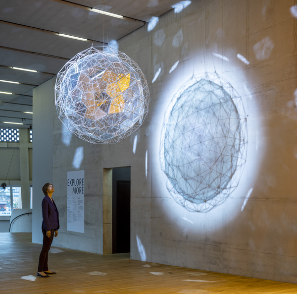 Olafur Eliasson, Stardust particle, 2014, Stainless steel, translucent mirror-filter glass, wire, motor, spotlight, diameter 170 cm. Installation view: Tate Modern, London, 2019. Photo: Anders Sune Berg. Tate Collection © 2014 Olafur Eliasson