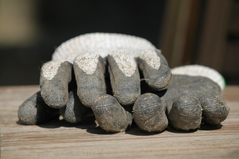 work gloves on work bench