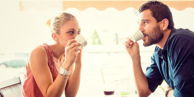 Young couple drink coffee at italian caf�©