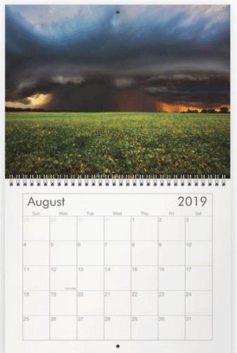 Summer storm across a farm field