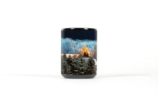 Center view of winter scene on black mug