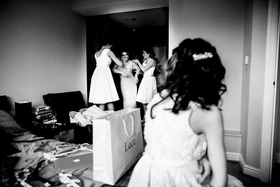 bride putting on wedding dress
