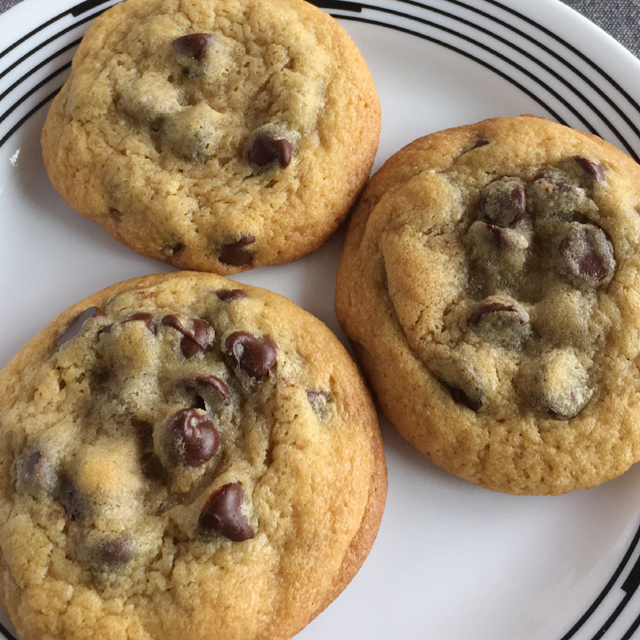 Three Classic Chewy Chocolate Chip Cookies on a white plate