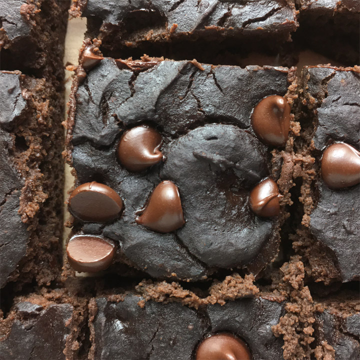 Close-up of a square brownie topped with chocolate chips