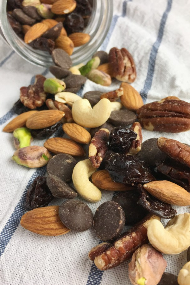 DIY Salty Sweet Trail Mix consisting of cashews, pecans, almonds, chocolate chips, pistachios, and dried cherries
