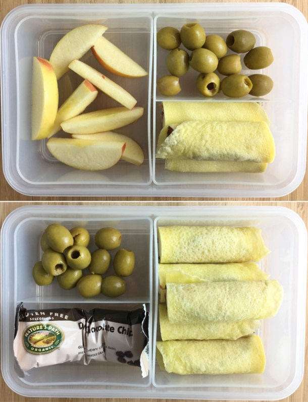 Two lunch boxes with olives, apples, and granola bar with Flourless Crepe Tortillas used as roll-ups