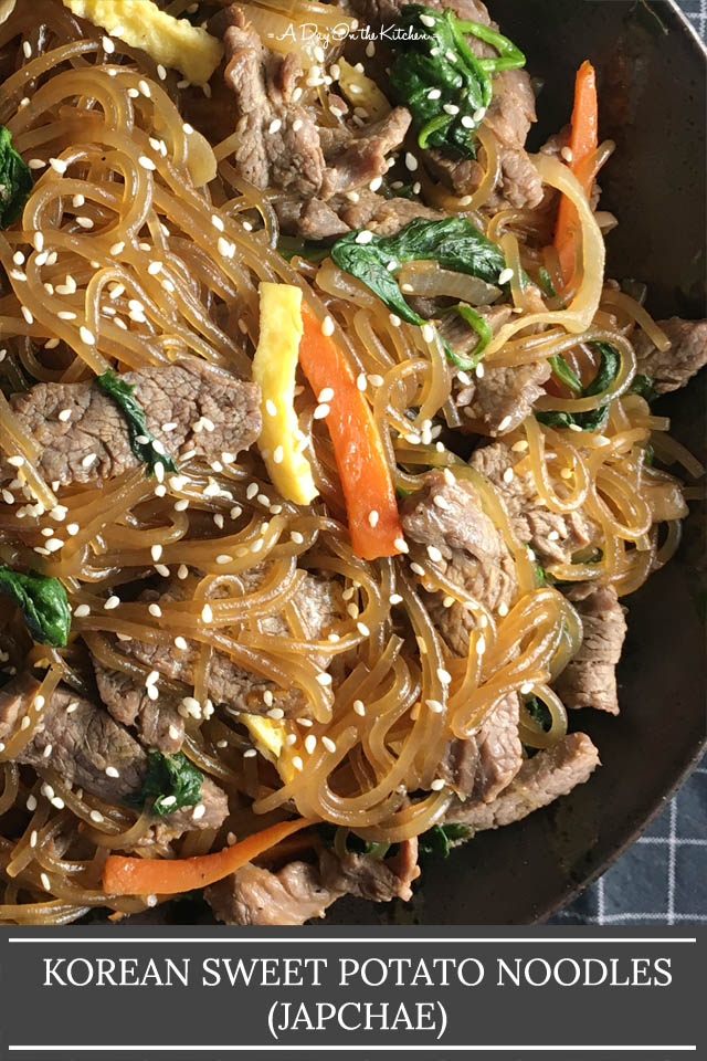 A black round dish containing nooldes and beef, text that says Korean Sweet Potato Noodles (Japchae)